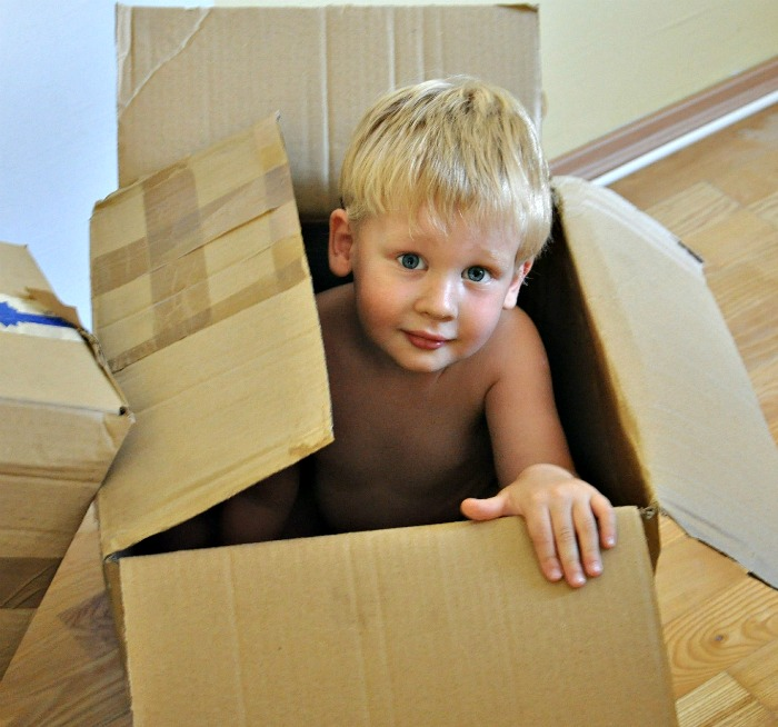 child in a packing box