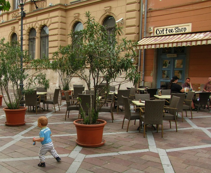 Child running at a coffee shop