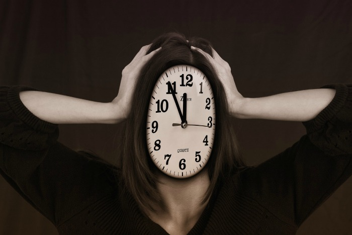 Woman stressed with a clock face