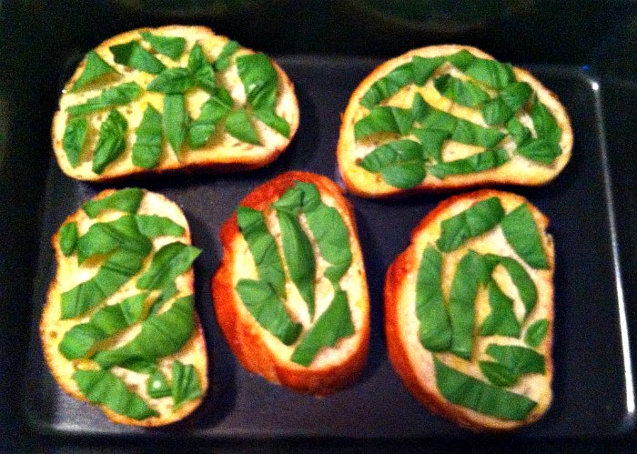 baguette slices with fresh basil strips