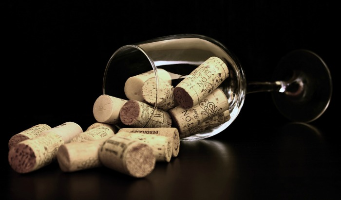 wine glass filled with corks