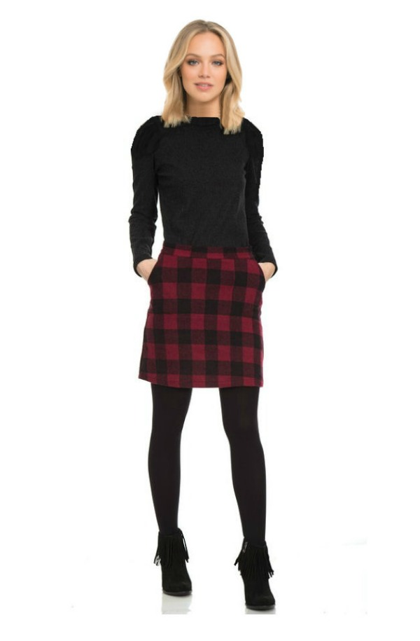 girl in a plaid wool skirt with black top and leggings