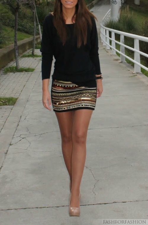 Girl in a gold striped skirt with a black sweater