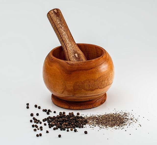 mortar and pestle with peppercorns