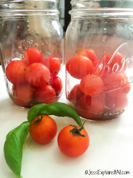 Cherry tomatoes in two Mason jars
