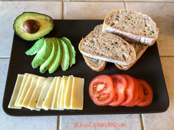 avocado, bread, cheese and tomatoes