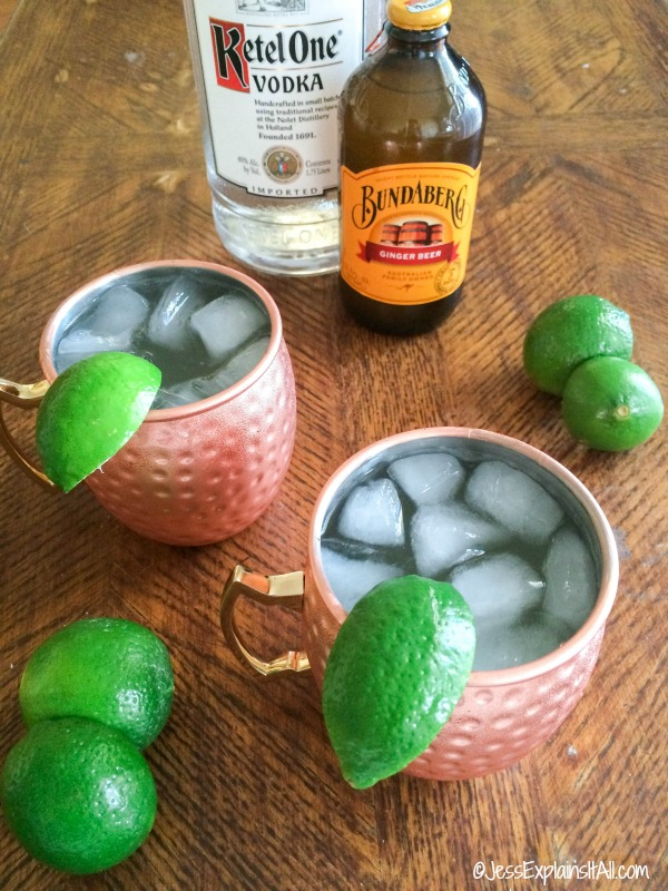 Ginger beer Vodka and limes with 2 copper mugs