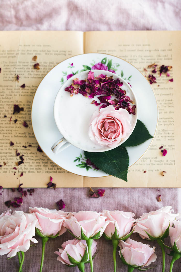 The perfect cup of tea, styled with a book and roses.