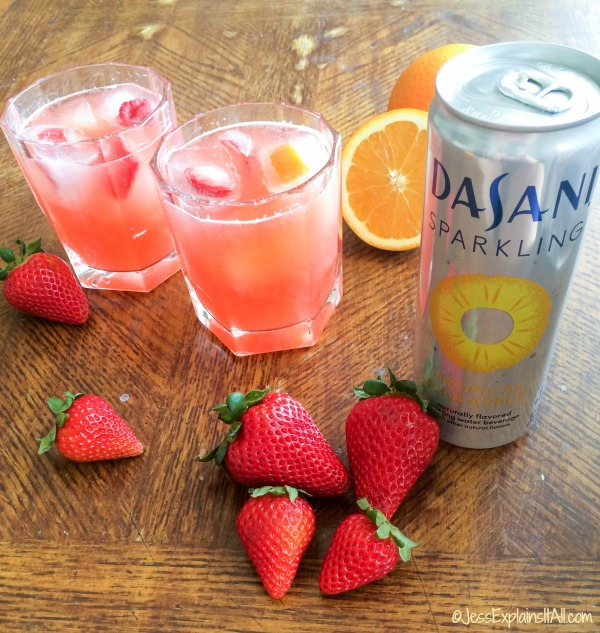 Two tropical mocktails in glasses next to a can of Dasani Sparkling Pineapple water.