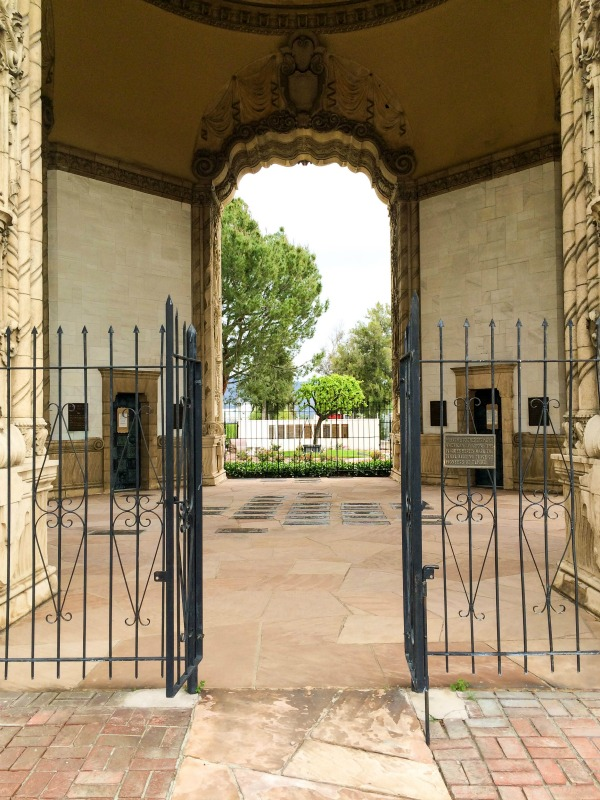 An open gate leading in to a monument.