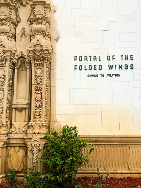 A closeup of the text on the portal of the folded wings, a shrine to aviation.