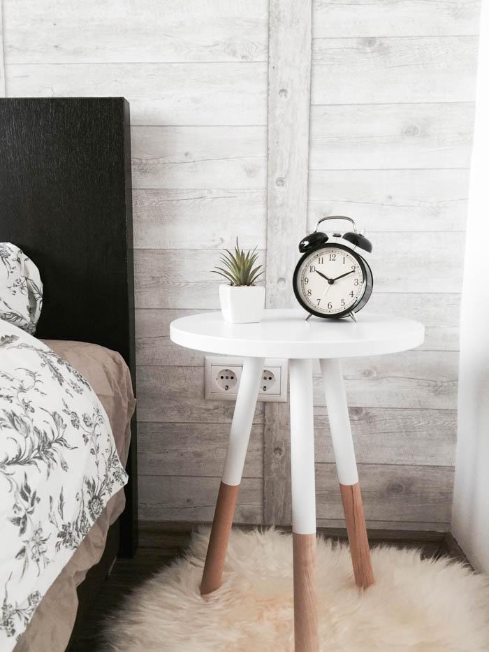 An alarm clock on a bedside table.
