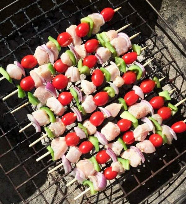 cooking chicken kebabs on a grill