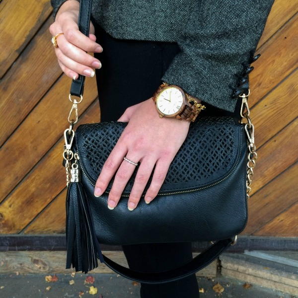 wood watch and black handbag