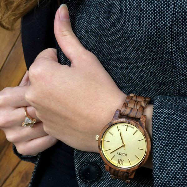 Hands with a Jord Wood watch