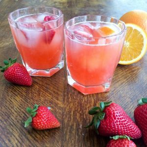 Tropical mocktails in glasses with strawberries