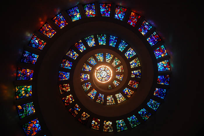 A colorful spiral made of stained glass on the ceiling.