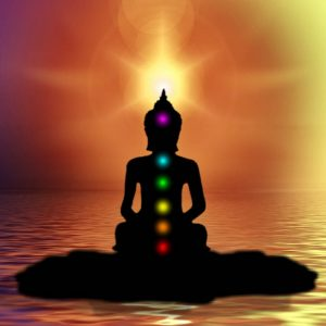 Silhouette with the chakra system illuminated by colored dots.