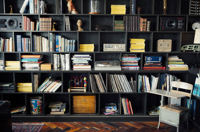 A wall filled with bookshelves and books, a home library.