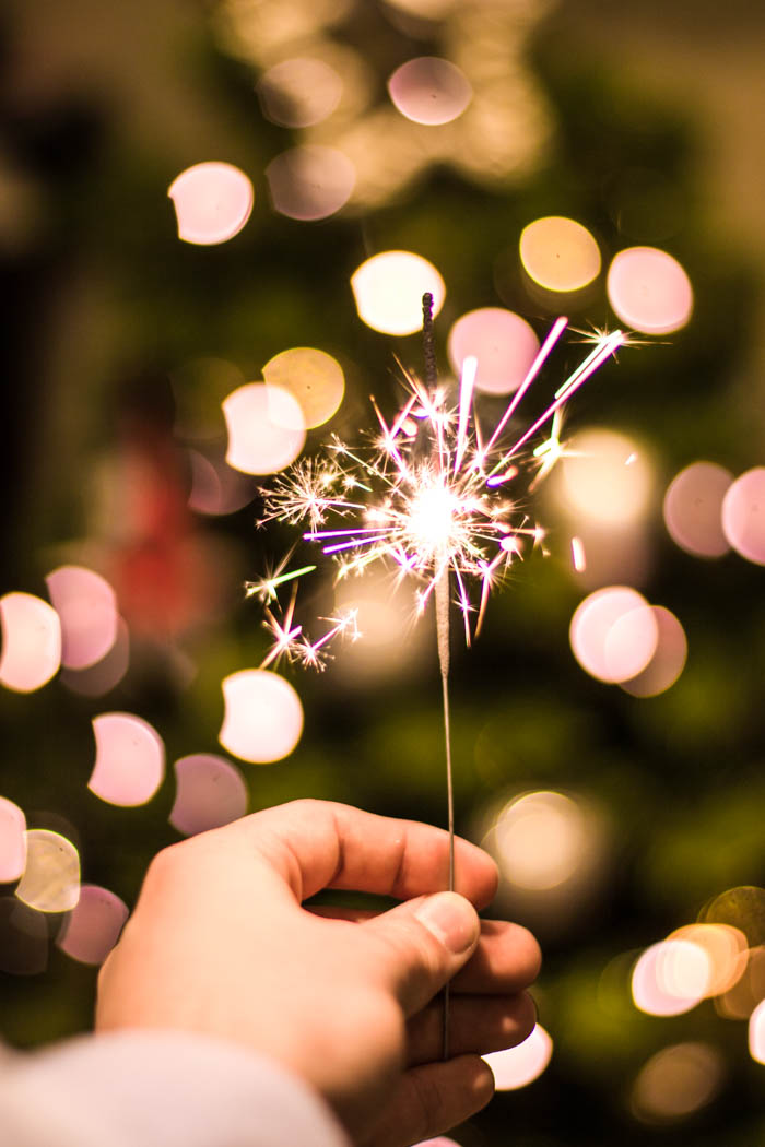 a pink sparkler with bokeh in the background