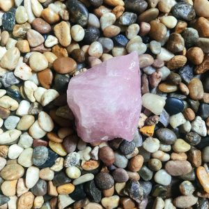 a pile of stones with rose quartz on top.
