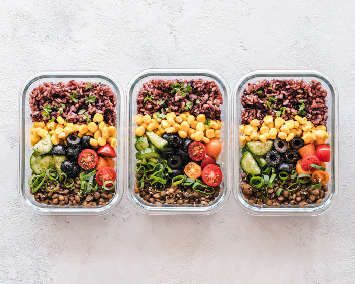 Meal prep containers with three days of healthy food.