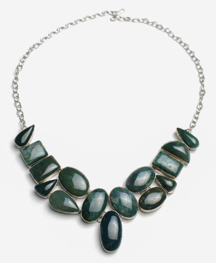 A bloodstone necklace, comprised of several bloodstone cabochons.