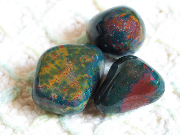 Three pieces of bloodstone meaning good health, increased endurance, and energy.