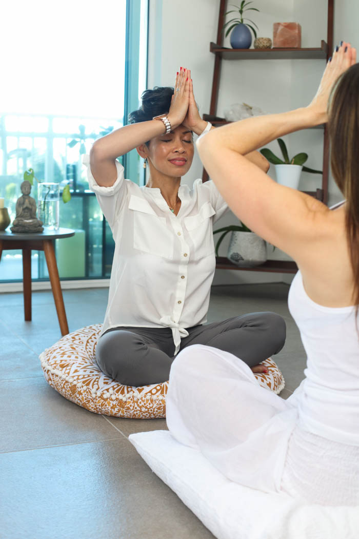 Two women in a guided meditation session.